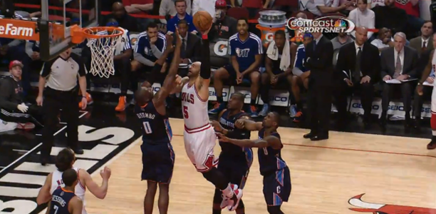 Carlos Boozer dunks on Bismack Biyombo