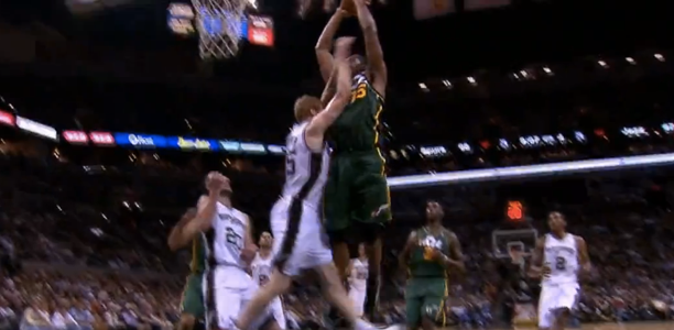 Derrick Favors dunks on Matt Bonner