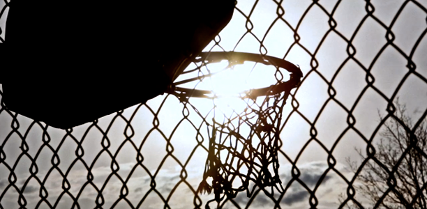 Basketball-Hoop-Through-Chain-Fence